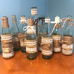 Rustic burlap, lace and rope covered bottles